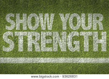 Soccer field with the text: Show Your Strenght