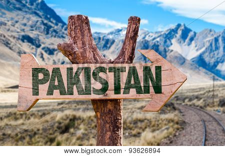 Pakistan wooden sign with desert road background