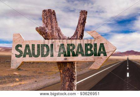 Saudi Arabia wooden sign with desert road background