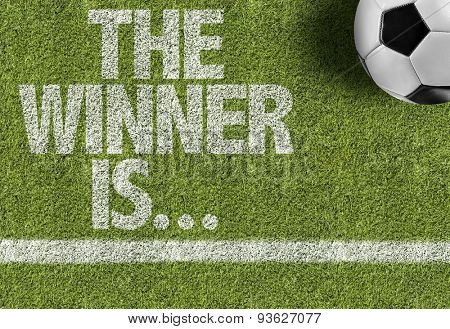 Soccer field with the text: The Winner Is...