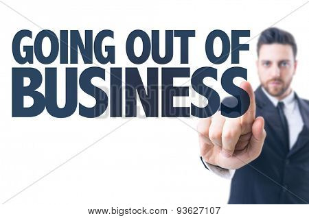 Business man pointing the text: Going Out Of Business