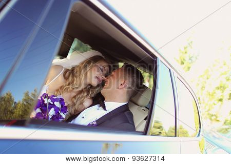 Bride And Groom Having Fun In The Car