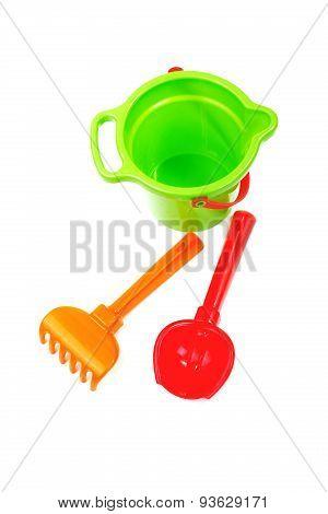 Children's Toys  Bucket  Shovel And  Rake On The White
