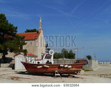 A wooden fishing vessel on a boat slipway