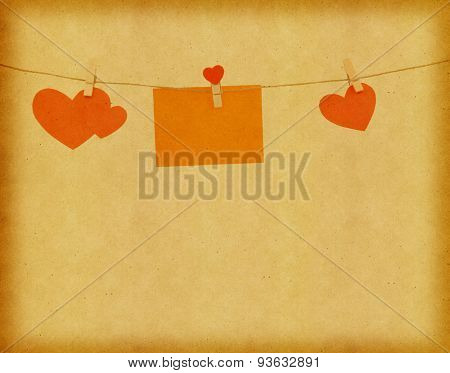 Cut out paper hearts fixed on a rope with clothespins