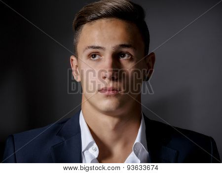 young businessman isolated on gray