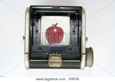 Vintage Box Camera With Apple In Viewfinder