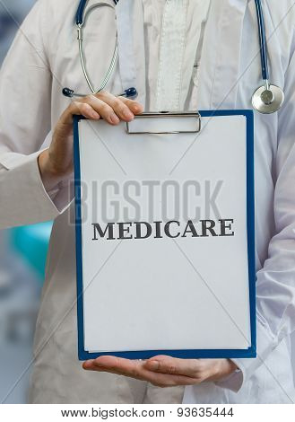 Doctor Holds Clipboard With Medicare Written