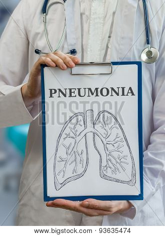 Doctor Holds Clipboard With Pneumonia Diagnosis