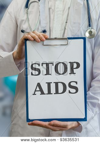 Doctor Holds Clipboard With Stop Aids Written