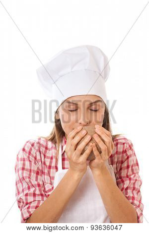 Baker smelling bread dough to check quality, isolated on white background