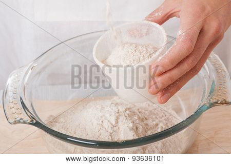 female hands knead the dough, isolated on white background