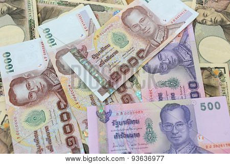Banknotes Of The Japan And Thailand Money.
