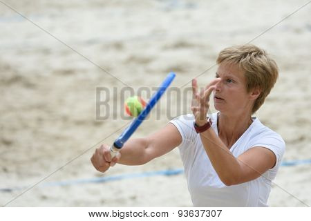 MOSCOW, RUSSIA - MAY 31, 2015: Daria Churakova in the match of Russian beach tennis championship. 120 adults and 28 young athletes compete in the tournament