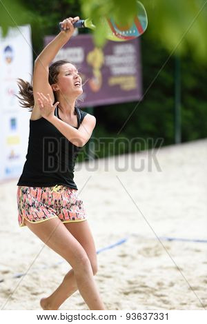 MOSCOW, RUSSIA - MAY 31, 2015: Yulia Chubarova in the match of Russian beach tennis championship. 120 adults and 28 young athletes compete in the tournament