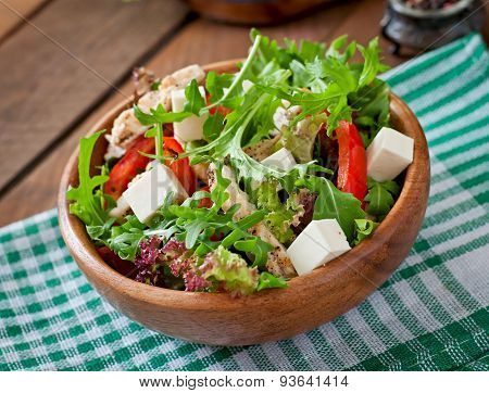 Dietary salad with chicken, cheese feta arugula and sweet red pepper