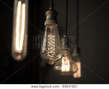 Hanged Light Bulbs In Dark Room Vintage
