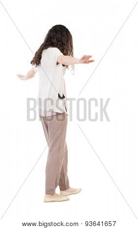 Back view woman is balancing on a tightrope.   Standing young girl in parka. Rear view people collection.  Isolated over white background. The girl goes on a tightrope tightrope walker