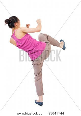 skinny woman funny fights waving his arms and legs. Rear view people collection.  backside view of person.  Isolated over white background. African-American woman kick foot.