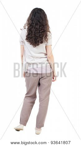 back view of standing young beautiful  woman.  girl  watching. Rear view people collection.  backside view of person.  Isolated over white background. The girl is in a relaxed position.
