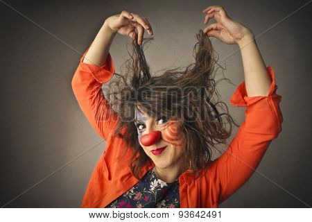 Funny clown playing with her hair