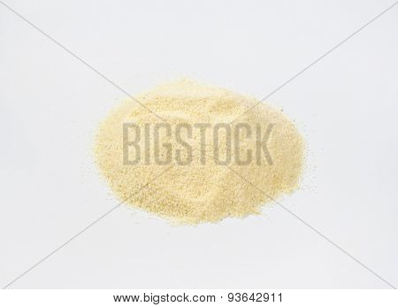 handful of grits on white background