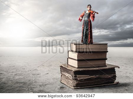 Woman standing on a pile of books