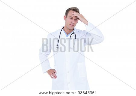 Worried young doctor in white tunic on white background