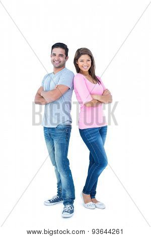 Happy friends with arms crossed back to back on white background