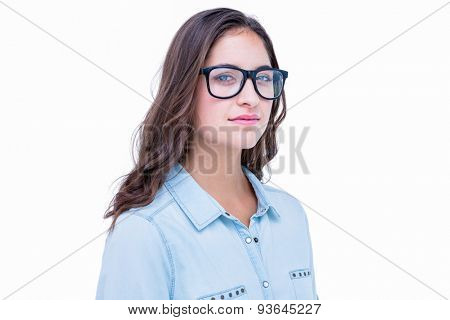 Pretty geeky hipster looking at camera on white background