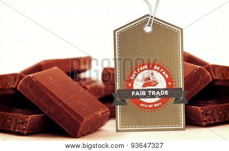 Fair Trade graphic against chocolate pieces piled together