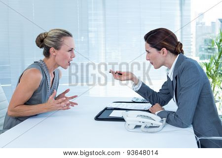 Businesswoman yelling at colleague in an office