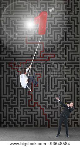 Businessman shooting a bow and arrow against maze