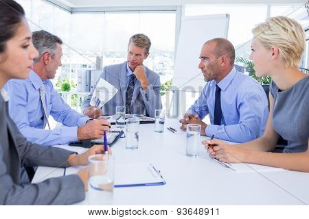 Business people speaking together during meeting in the office
