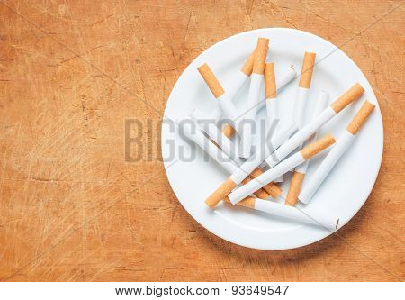 Cigarette On A Plate Top View