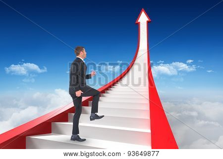 Businessman walking with his leg up against bright blue sky over clouds