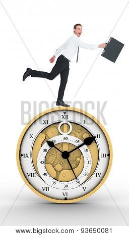 Happy businessman leaping with his briefcase against pretty looking clock