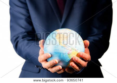 Hand of businessman holding terrestrial globe on white background