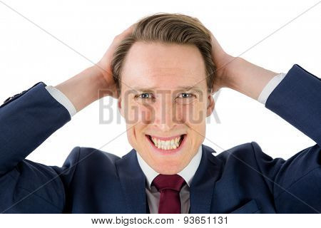 Nervous businessman looking at camera with hand on head on white background