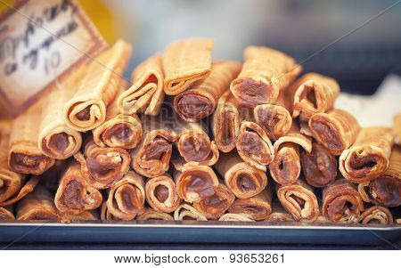 Rolled waffles pile on the tray