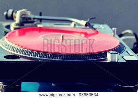 closeup of spinning dj disk and headphone