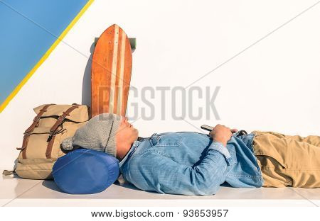 Young Hipster Man Having A Rest During A Ferry Boat Passage Holding His Smartphone  - Modern Concept