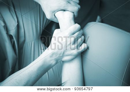 Physiotherapist Massaging Patient Mobility Injury
