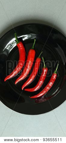 Cayenne Pepper On Black Plate