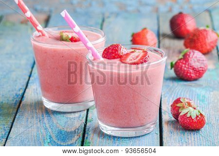 Two Glasses Of Strawberry Smoothie With Straws