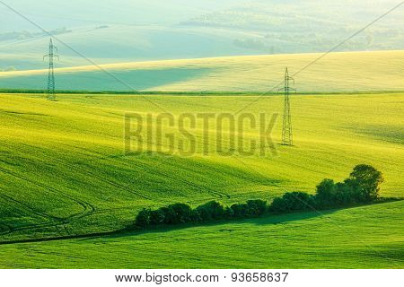 Moravian summer rolling landcsape with two power line tower. Moravia, Czech Republic