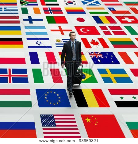 business man travels the world walking on a background of international flags