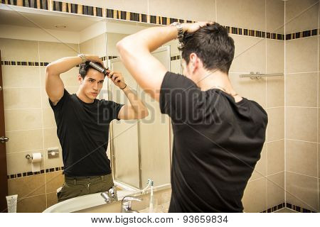 Reflection of Man Bushing Hair in Mirror