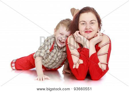 Happy son hugs a beloved mother , close-up