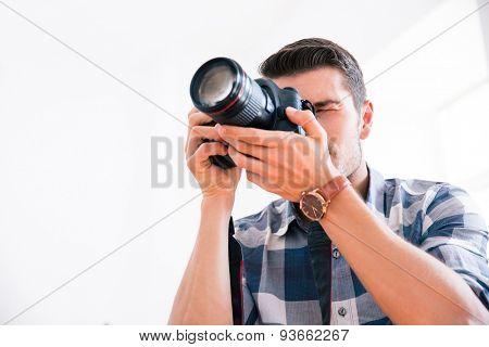 Casual man using photo camera